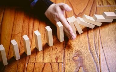 Compliance Domino Hand.jpg