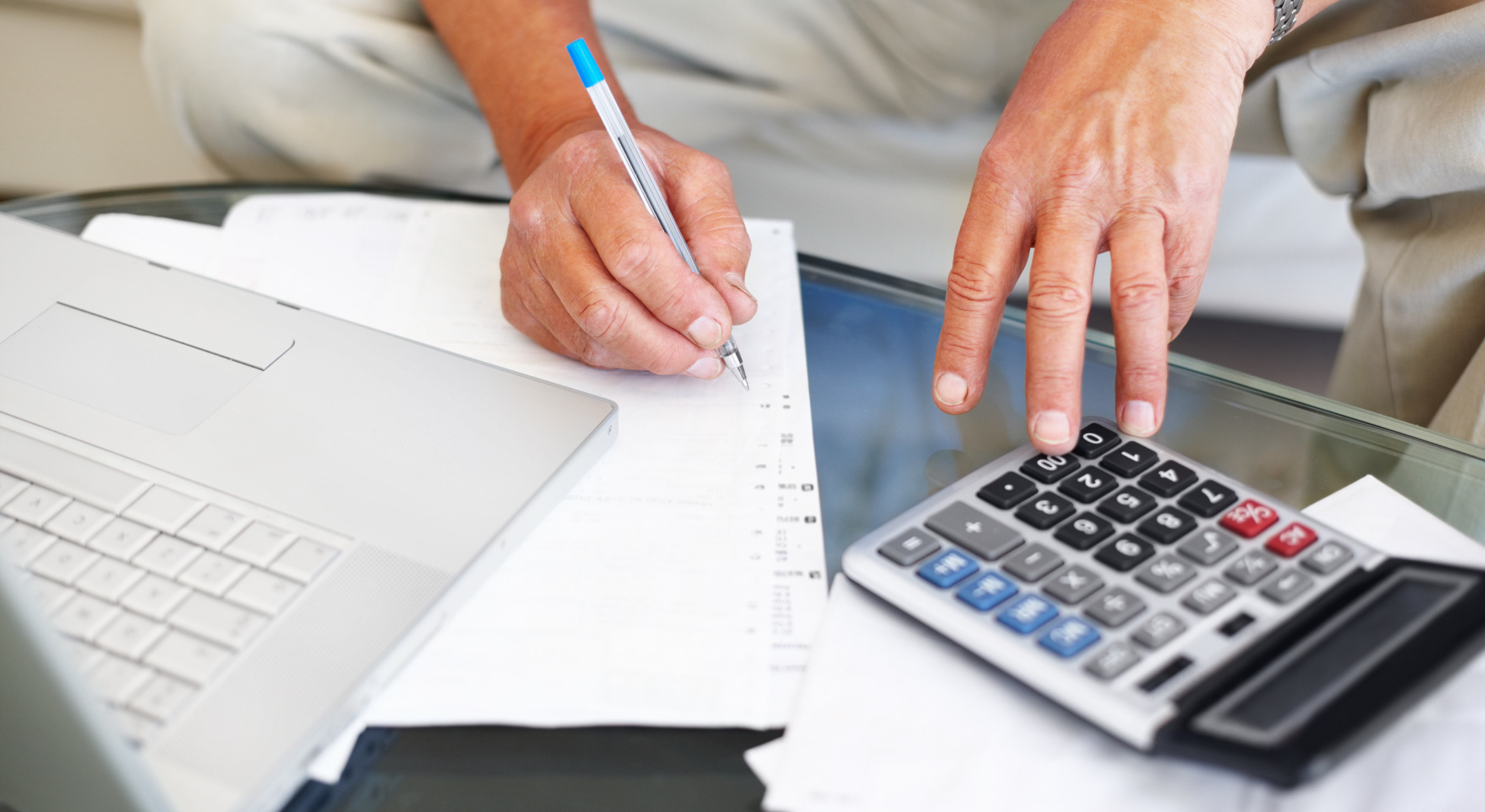 mid-section-of-a-senior-man-calculating-financial-budget-2.jpg